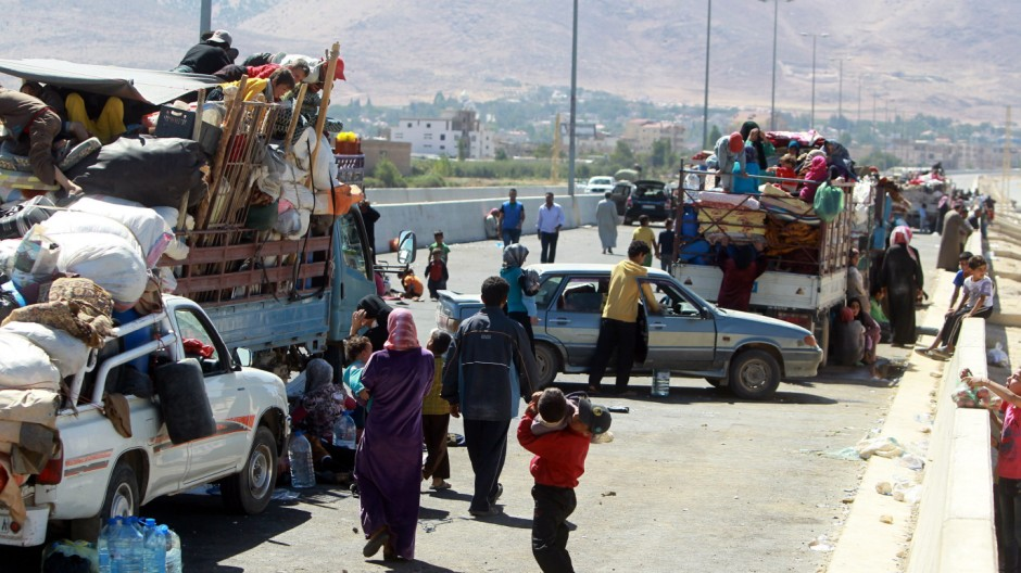 Syrian refugees flee conflict in Lebanon