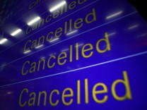 An electronic information board displays cancelled flights at Frankfurt airport