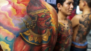 Competitors show their tattoos at the MBK Tattoo Contest 2014 in a shopping mall in Bangkok