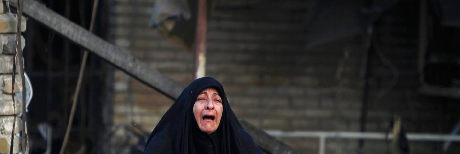 A woman reacts at the site of Tuesday's car bomb attack, in Kadhimiya neighbourhood , Baghdad