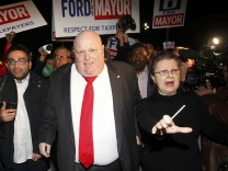 Rob Ford leaves the hall after speaking to supporters after being elected as a councillor in the municipal election in Toronto