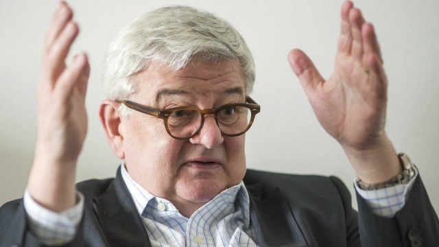 Former German foreign minister Joschka Fischer gestures during an interview with Reuters in Berlin