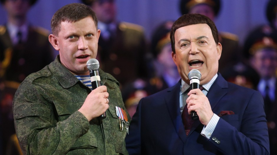 Iosif Kobzon (R), Russian singer and a deputy of the State Duma, Russia's lower house of Parliament, and Alexander Zakharchenko, separatist leader of the self-proclaimed Donetsk People's Republic, sing during a concert, in Donetsk