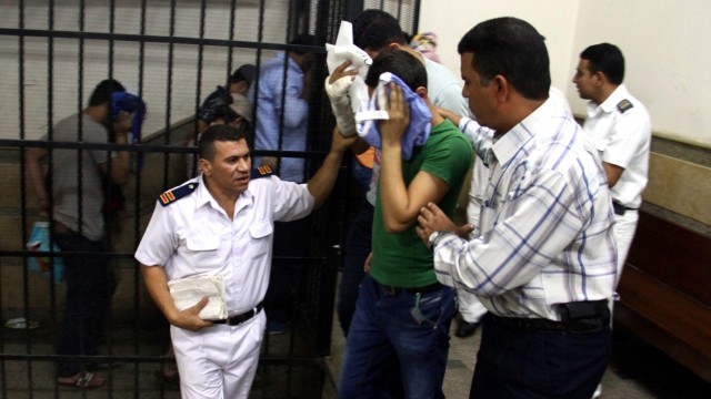 Egyptian court jails eight men over gay marriage video
