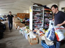 Spendenannahme in einem Münchner Flüchtlingsheim, 2014