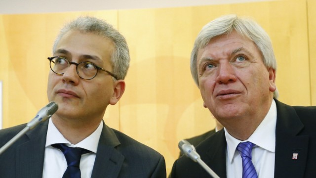 Wazir and Bouffier sit on the treasury bench at the state parliament in Wiesbaden