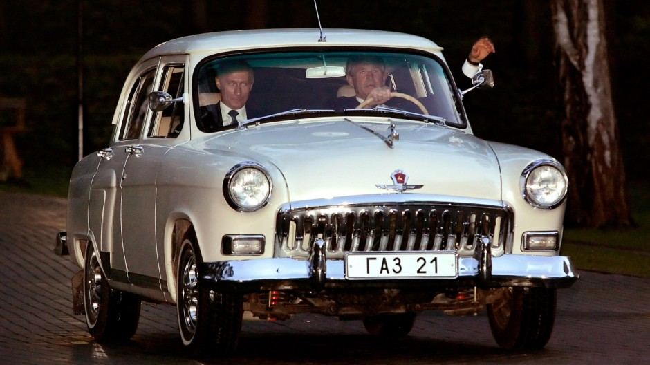 File photo of Russian President Vladimir Putin sitting in the passenger seat as US President George W. Bush waves in Novo Ogarevo