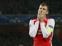 Arsenal's Mertesacker reacts after their Champions League soccer match against Anderlecht at the Emirates stadium in London