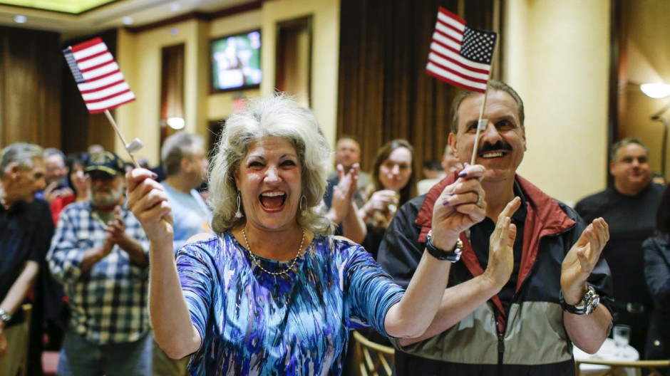 Supporters of Republican Michael Grimm celebrate after he was re-elected in the midterm elections in Staten Island