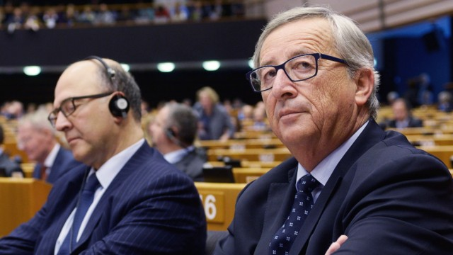 European Commission President Juncker and Moscovici, the European Commissioner for economics, taxation and customs, attend a session at the European Parliament in Brussels
