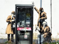 Apparent Banksy graffiti on surveillance surfaces