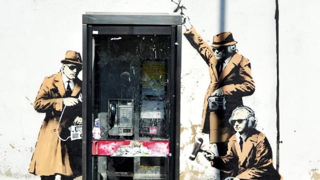 Apparent Banksy graffiti on surveillance surfaces