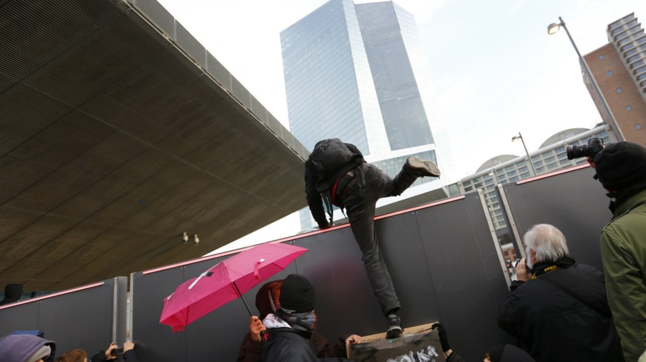 Blockupy protesters get over a fence to the new European Central Bank (ECB) headquarters during a demonstration in Frankfurt
