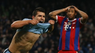 Manchester City's Aguero celebrates after he scored the winning goal as Bayern Munich's Boateng reacts during their Champions League Group E soccer match in Manchester