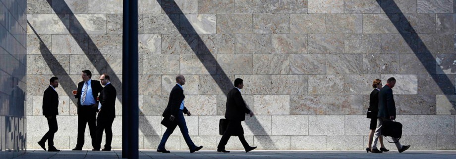File photo of employees of the Deutsche Bank walking in front of the Deutsche Bank headquarters  in Frankfurt