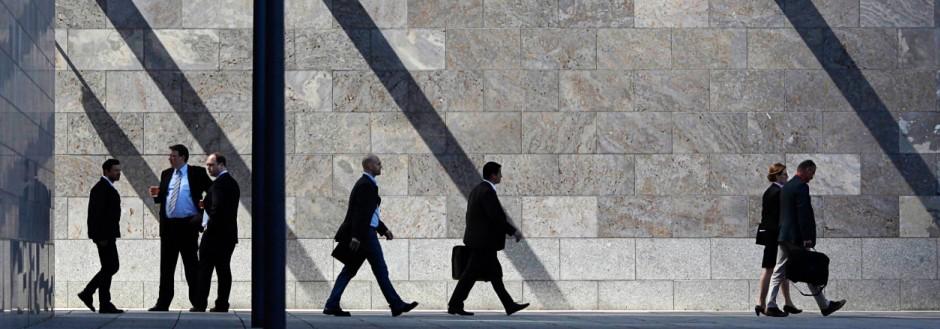 File photo of employees of the Deutsche Bank walking in front of the Deutsche Bank headquarters  in Frankfurt