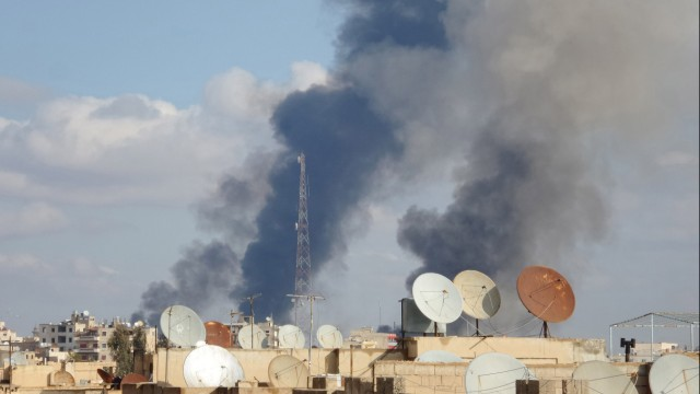 Smoke rises after what activists said were airstrikes by forces loyal to Syria's President Assad in Raqqa, which is controlled by the Islamic State