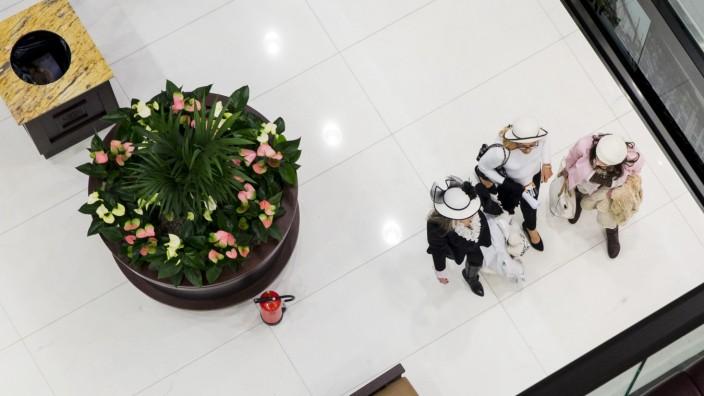 Women walk through Mall of Berlin shopping centre during its opening night in Berlin