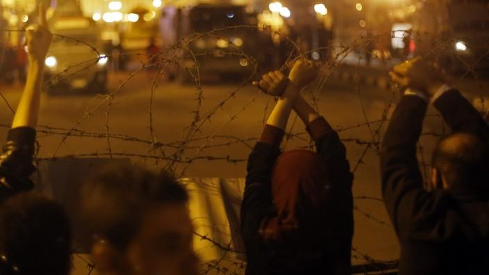 Anti-Mubarak protesters gesture after former Egyptian President Hosni Mubarak's verdict in Cairo