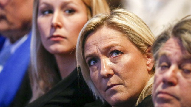 Marine Le Pen (C), France's National Front political party leader, and French National Front party deputy Marion Marechal-Le Pen attend the far-right party's congress in Lyon