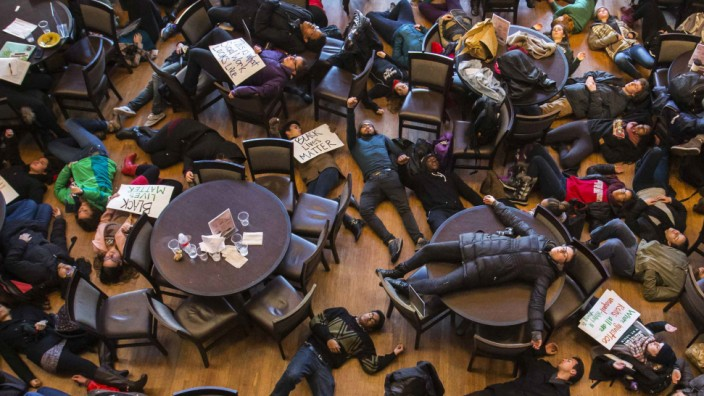 Student activists stage a 'die-in' as part of the nationwide 'Hands up, walk out' protest at Washington University in St. Louis