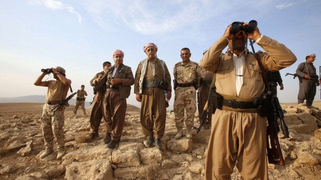 File photo of Kurdish Peshmerga forces standing guard near the town of Makhmur, south of Erbil, capital of Iraqi Kurdistan after Islamic State (IS) insurgents withdrew