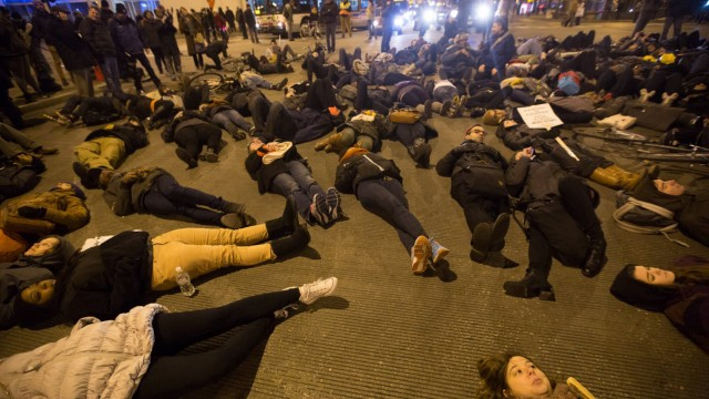 141205 CHICAGO Dec 5 2014 Protesters lie on a street of Chicago the United States on nig