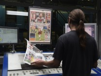 A printer controls files of German newspaper 'Bild' after Germany won the 2014 Brazil World Cup final soccer match, at printing plant in Berlin