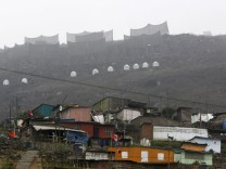 Nets that trap moisture from fog are seen on the hillside of Villa Maria Del Triunfo in Lima