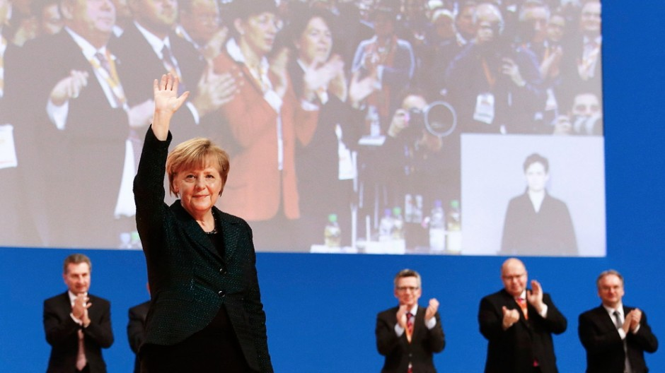German Chancellor Merkel waves after she delivered her speech at the Christian Democratic Union (CDU) party convention in Cologne