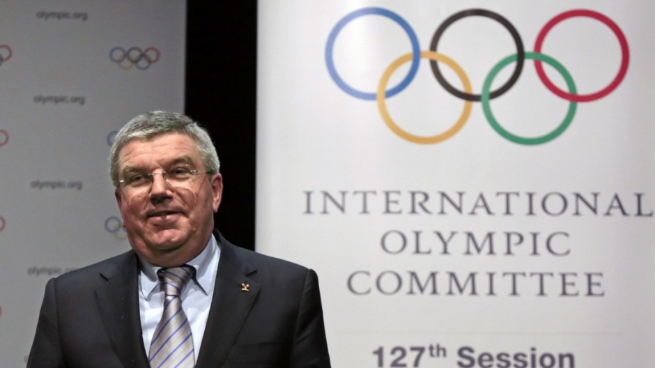 IOC President Bach smiles following a news conference as part of the IOC Executive Board meeting in Monaco