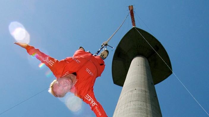 JOCHEN SCHWEIZER PERFORMS A BUNGEE JUMP OFF THE DANUBE TOWE IN VIENNA