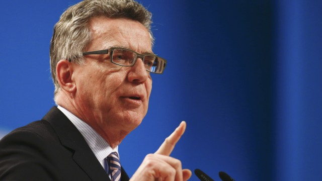 German Interior Minister de Maiziere addresses the CDU party convention in Cologne