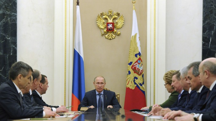 Russia's President Putin chairs a meeting with permanent members of the Security Council at the Kremlin in Moscow