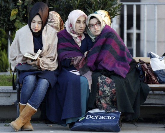 Relatives and supporters of people who were detained wait outside the Justice Palace in Istanbul
