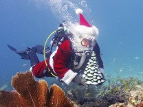 Handout of Slate, garbed as Santa Claus, scuba dives in the Florida Keys National Marine Sanctuary, off the coast of Islamorada
