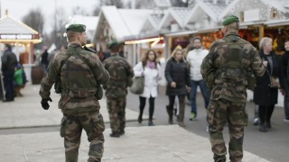 French soldiers patrol the Christmas market on the Champs Elysees in Paris as part of the 'Vigipirate' security plan