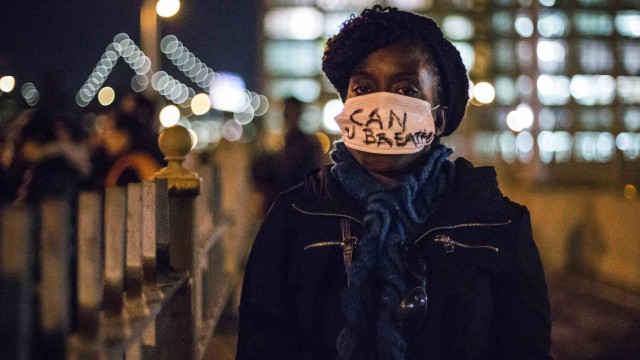 A female protester, demanding justice for Eric Garner, sports a face mask in Brooklyn, New York