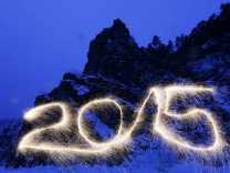 Number '2015' is written in the air with a sparkler at the frozen Mana River in the Taiga district outside Russia's Siberian city of Krasnoyarsk