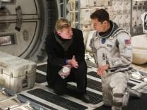 """Christopher Nolan (links) und Matthew McConaughy beim Dreh von """"Interstellar""""."""