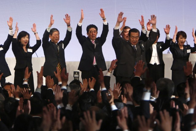 File photo of Japan's PM Abe and Liberal Democratic Party members at annual party convention in Tokyo