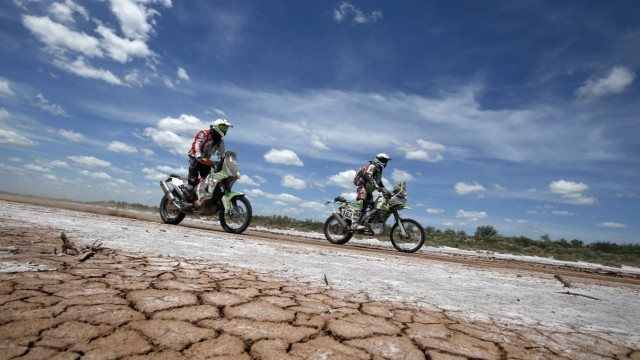 KTM rider Cherpin of France and Kawasaki rider Martinelli of  Argentina ride during the 2nd stage of the Dakar Rally 2015, from Villa Carlos Paz to San Juan