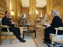 Marine Le Pen meets President Hollande at Elysee