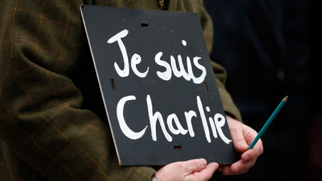 A man holds a 'Je suis Charlie' banner during a march in Liverpool