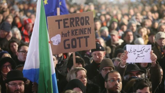 Muslims Hold Berlin Vigil Following Paris Attacks
