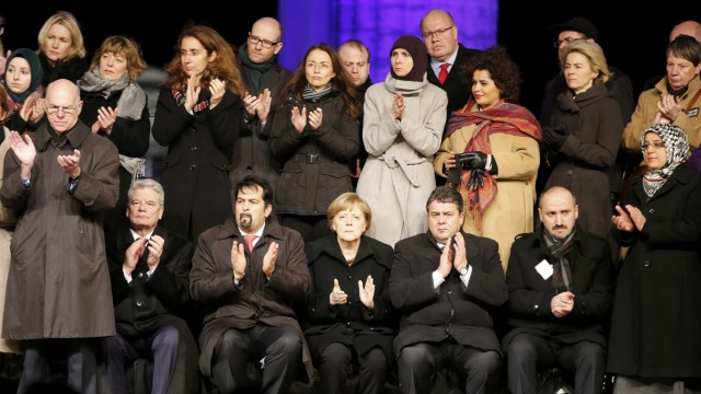 German Chancellor Merkel German President Gauck and Chairman of the Central Council of Muslims in Germany Mazyek attend vigil for victims of Paris attacks in Berlin