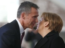 German Chancellor Merkel greets NATO Secretary General Stoltenberg at Chancellery in Berlin
