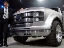 Ford Motor president of the Americas Mark Fields poses with Ford F-250 Super Chief concept at Detroit Auto Show