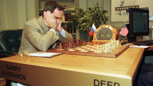 World chess champion Garry Kasparov studies the  board shortly before game two of the match against ..