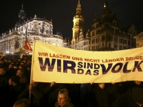 File photo of participants holding a banner during a demonstration called by anti-immigration group PEGIDA